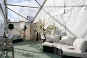 Sofas and plants on display at wedding fayre