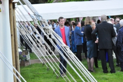 Guests gather outside the marquee