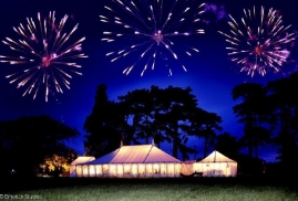 Marquees at night with Fireworks