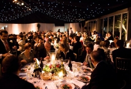 Guests Eating During Party Inside A Marquee At Night