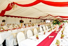 Marquee Decorated In A Red And White Theme