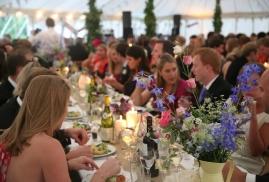 People-Eating-During-Party-Inside-A-Marquee