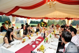 People Inside White And Red Themed Marquee During A Party