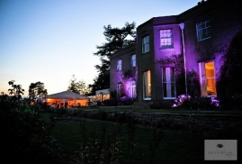 Purple-Lights-On-Country-House-Whilst-At-Marquee-Party