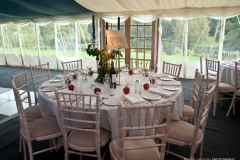 Chairs and tables decorated for the marquee party in Pudlestone Herefordshire