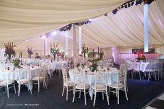 Tables and chairs inside the marquee