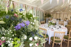 Andrew and Victorias marquee wedding with decorative flowers