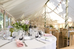 Tables decorated ready for wedding guests