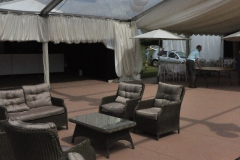 Outside furniture under marquee glorious sunshine