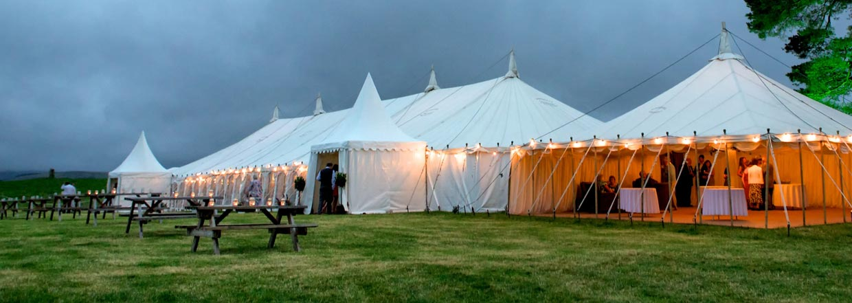 Traditional Marquee With Lights In Field
