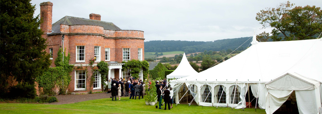 Traditional marquee in front of grand house