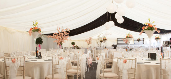 Wedding marquee with orange flowers