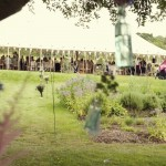 Cirencester Gloucestershire garden party wedding with guests enjoying themselves in the marquee