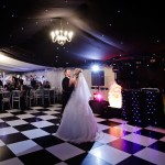 Black and white dance floor in marquee at wedding at Hampton Court Hope under Dinmore Leominster