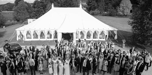 Marquee with wedding guests in the countryside